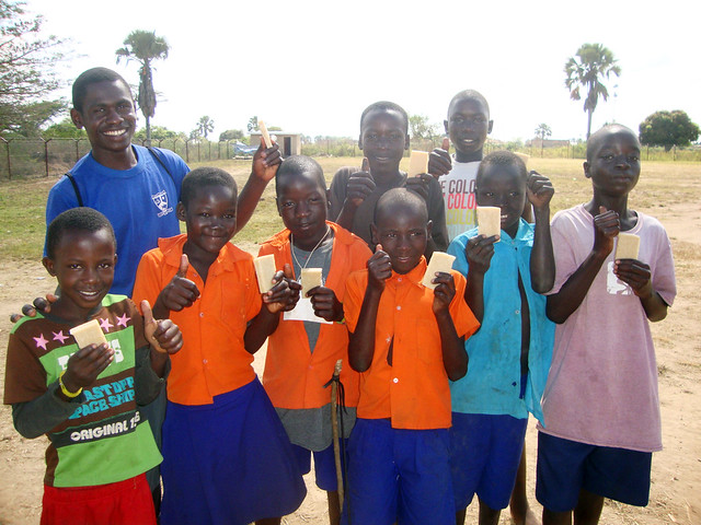 bright kids in Kabermaido, Uganda smiling at the camera
