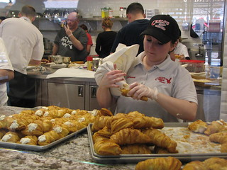 Carlo's Bakery worker fills pastry