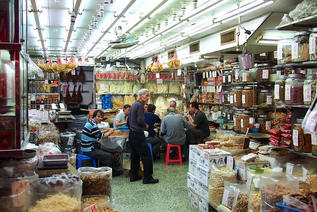 men eating in a Chinese medicinal shop. Hong Kong (Kowloon)