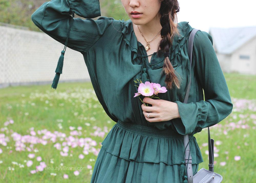 Green mini peplum dress with tassels