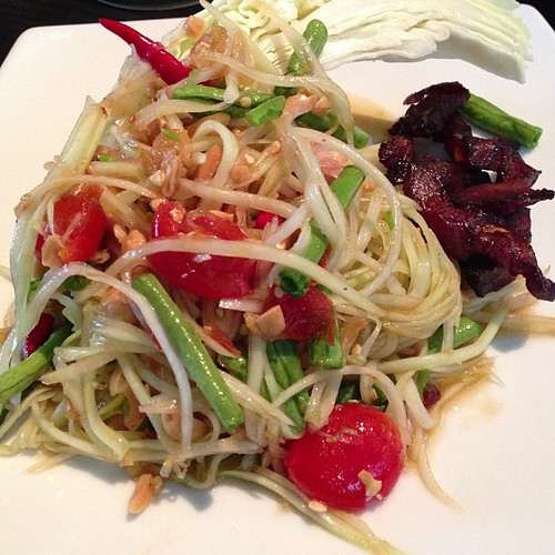 Som Dtum Malakor - Pounded green papaya salad, cherry tomatoes, chili, dried shrimp with a sweet & sour tamarind dressing with a side of candied pork. Kha Singapore.