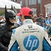 Simon Pagenaud is congratulated by Batman after winning the 2013 Grand Prix of Baltimore