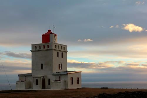 ocean sunset sea sky lighthouse clouds coast iceland dusk atlantic ísland vík promontory suðurland dyrhólaey picmonkey:app=editor