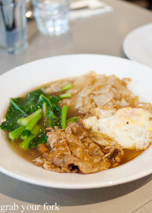 Rad na rim tanon flat rice noodle with pork, Chinese broccoli and fried egg at Rim Tanon Haymarket Chinatown