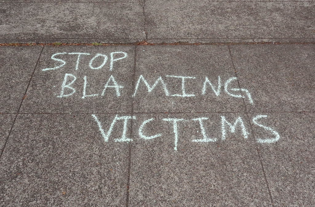 "chalk says, ""stop blaming victims"""
