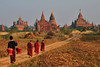 Young novice monks heading towards the pagodas of Bagan
