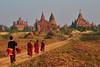 Young novice monks heading towards the pagodas of Bagan