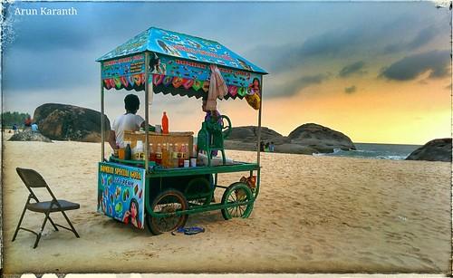sunset orange india beach water sand waiting streetphotography mobilecamera seller southindia nexus5