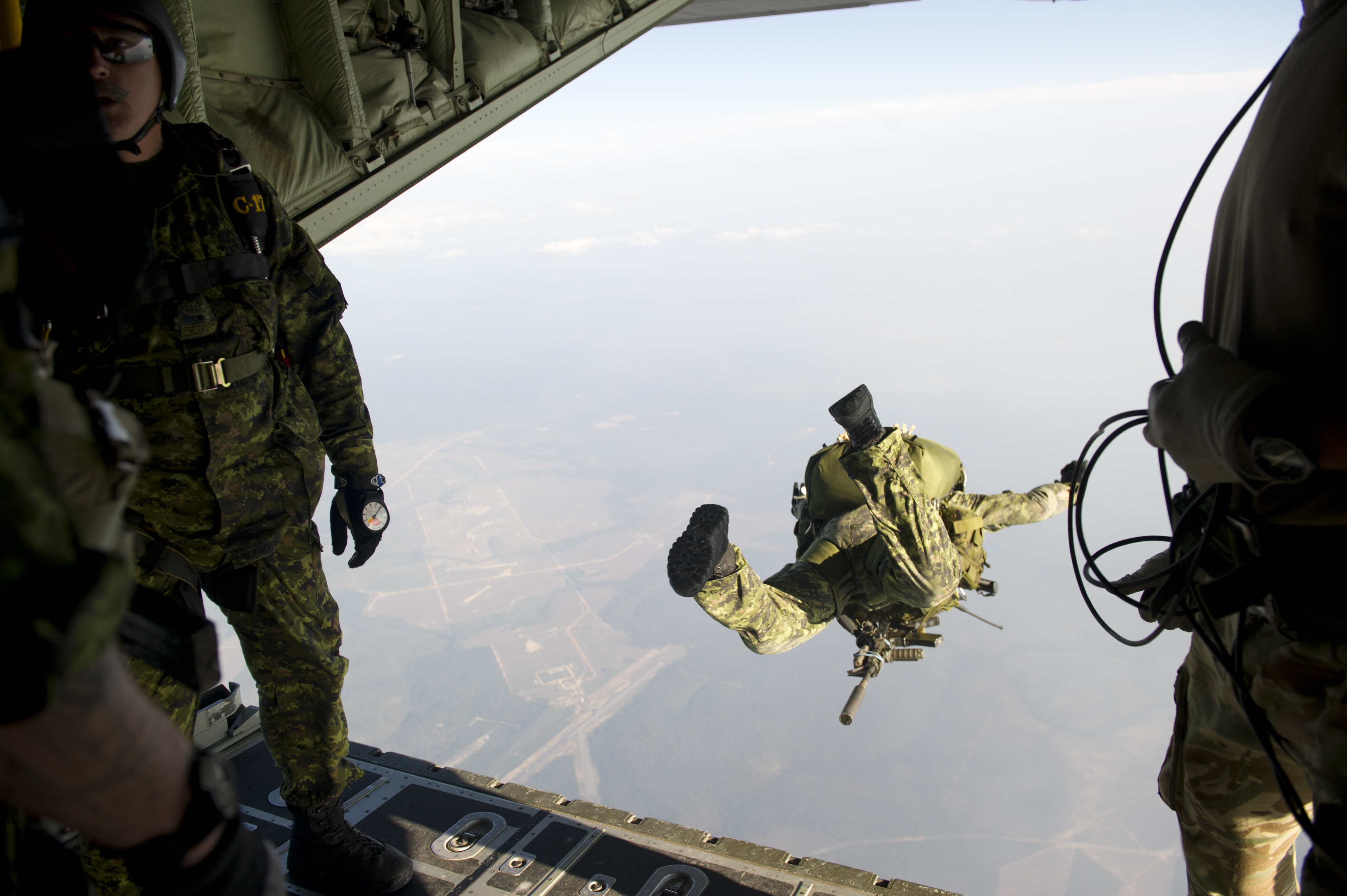 Jumpers from the Canadian Special Operations Regiment exit a British C-130 during a HALO jump near Hurlburt Field, Florida on April 25, 2013
