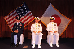 "Commander, U.S. Forces Japan Lt. Gen Salvatore A. ""Sam"" Angelella; Commander, U.S. Naval Forces Japan, Navy Region Japan, Rear Adm. Dan Cloyd, center; and his relief Rear Adm. Terry B. Kraft sit during a change of a command ceremony where Cloyd relinquished his command to Kraft. (U.S. Navy Photo by Mass Communication Specialist 2nd Class Adam K. Thomas)"