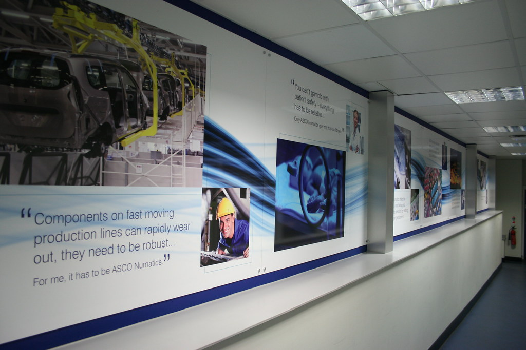 Aluminium composite panels with full colour digital print, mounted with chrome stand-off locators, complete with folded brushed stainless steel covering the uprights