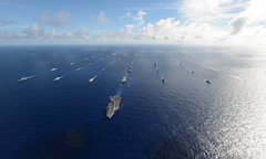 In this file photo, 42 ships and submarines representing 15 international partner nations steam in close formation during RIMPAC 2014. (U.S. Navy/MC1 Shannon Renfroe)