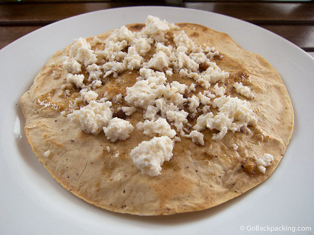 Flatbread with crumbled Oaxacan cheese
