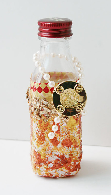 Mixed-media-on-upcycled-bottle