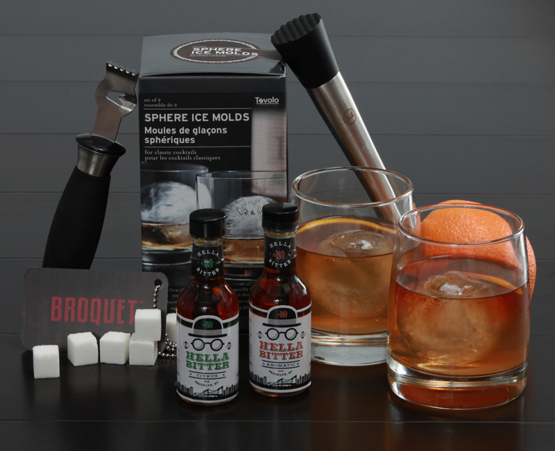 All of the bar tools, glassware, and cockail bitters necessary for any man to make an Old Fashioned like a gentleman