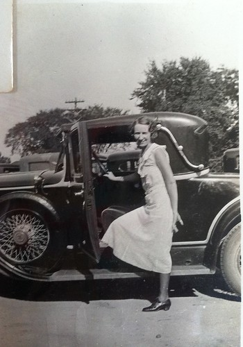 Cary Franklin posing with her father's car