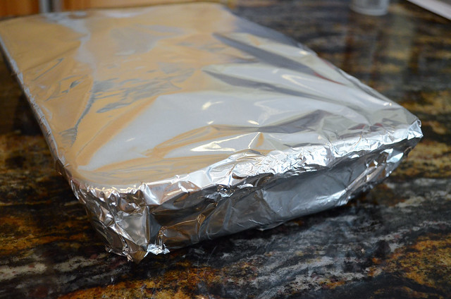 Foil is wrapped around the pan of lasagna.