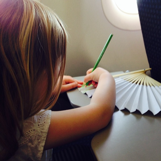 Keeping busy on the plane #paperfan #designyourown #spiralgarden