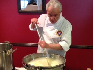 Michael Losurdo stirring first cook of fresh mozzarella