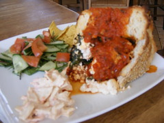 Rustica, bread filled with tomato,spinach and feta with a salad...