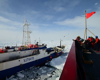 Seaman Nicholas Libbing, a member of deck force aboard Coast Guard Cutter Polar Star, uses a bolo to send a messenger line to the crew of the disabled fishing vessel Antarctic Chieftain, Feb. 14, 2015. Antarctic Chieftain became disabled and beset by ice near Cape Burks, Antarctica. Polar Star's crew has been underway in Antarctica in support of Operation Deep Freeze 2015, part of the U.S. Antarctic Program, managed by the National Science Foundation. (U.S. Coast Guard photo by Petty Officer 1st Class George Degener)