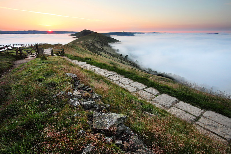 A cloud inversion on Mam Tor and the Great Ridge in the Derbyshire Peak District at sunrise.