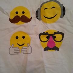 hairstyle(0.0), icon(0.0), stuffed toy(0.0), toy(0.0), textile(1.0), moustache(1.0), yellow(1.0), smiley(1.0), cartoon(1.0),