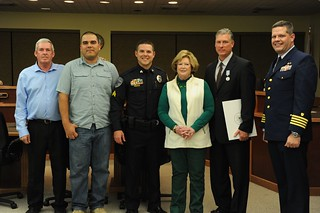 NEW SMYRNA BEACH, Fla. - Coast Guard Sector Jacksonville, Fla., Commander Capt. Tom Allan (right) presented awards during a ceremony Tuesday, Jan. 28, 2014 to Wayne Mechtel, Christopher Kirk, and New Smyrna Beach Mayor Adam Barringer for saving the life of Suzanne Grims after a vehicle accident sent her car into the Indian River Jan. 6, 2010. The men were near the site of the accident when it occured and immediately jumped into the river to rescue Grims as her car sank in the river. (U.S. Coast Guard photo by Petty Officer 1st Class Lauren Jorgensen)