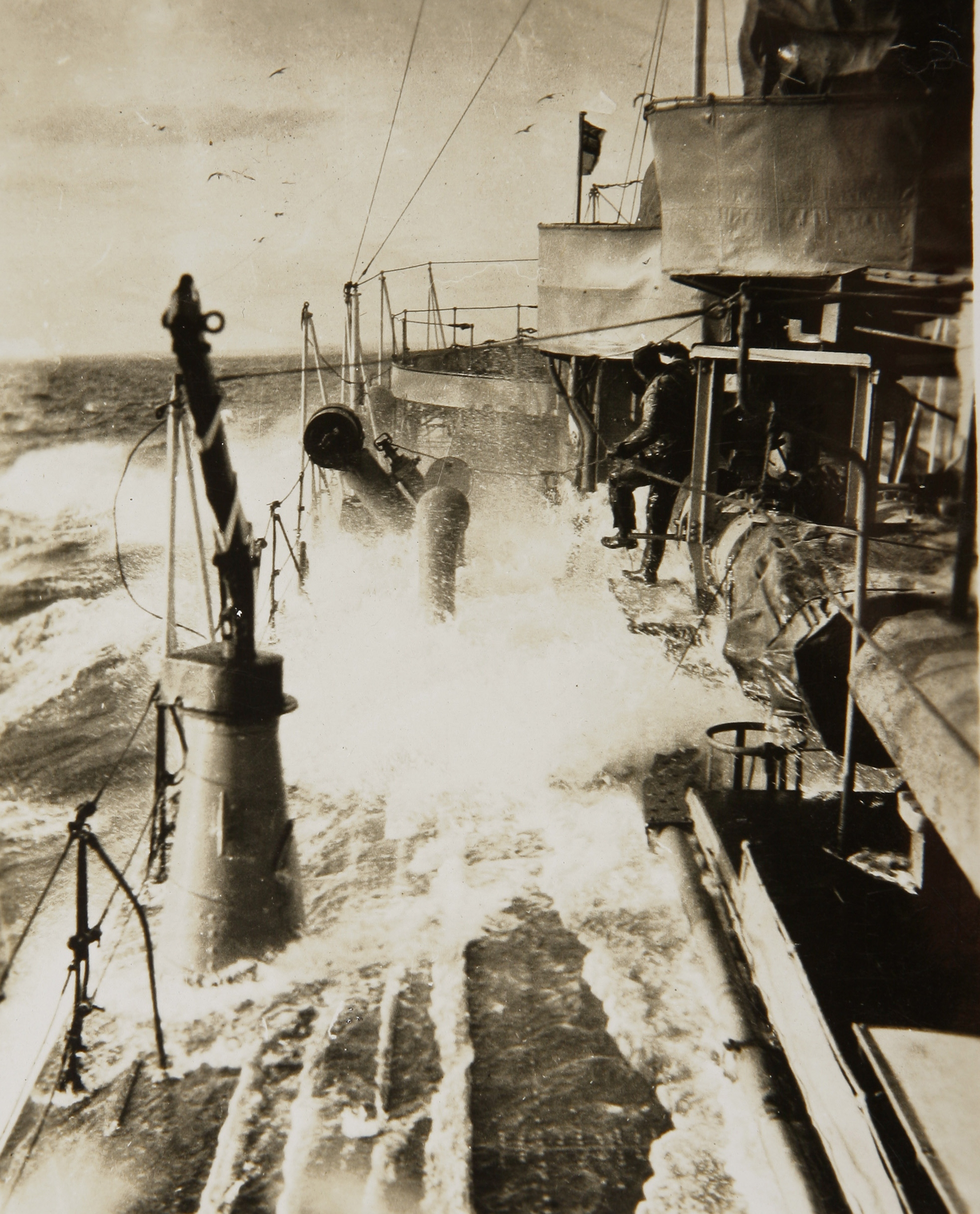 HMAS Sydney ploughing through a rough sea