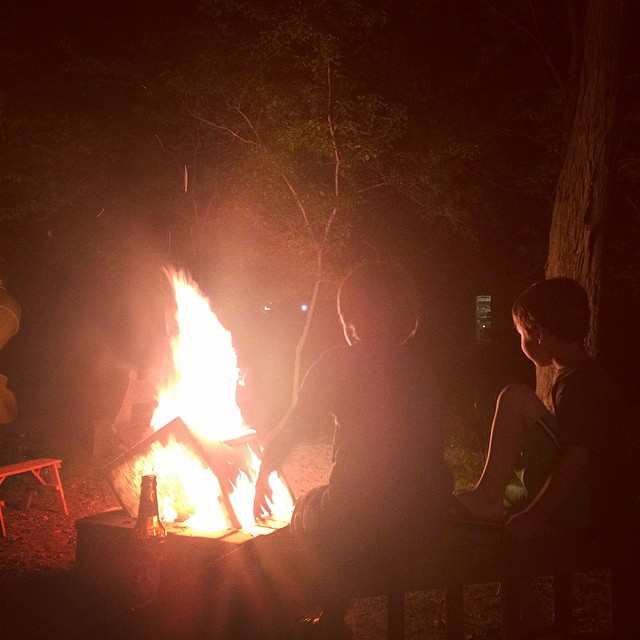 Boys watching bonfire