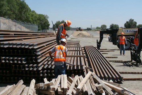 Photo of steel rail storage at Sheridan Station site