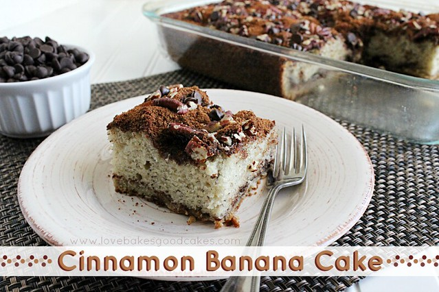 Cinnamon Banana Cake slice on a plate with a fork and a bowl of chocolate chips.