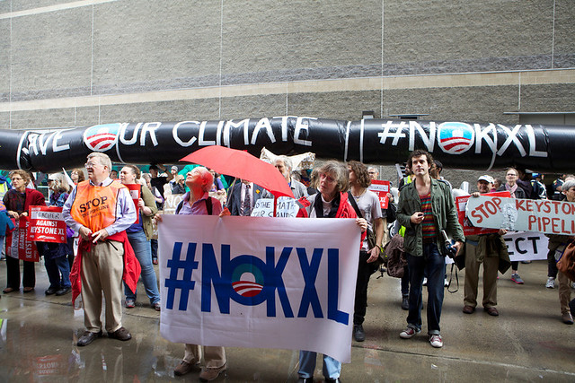 Hundreds braved the Boston rain to tell the State Department no tar sands pipeline. Photo by Kayana Szymczak