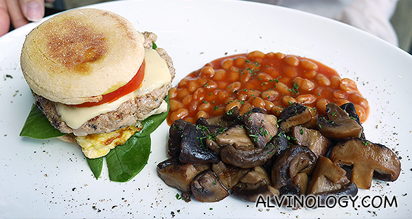 Breakfast burger with sauteed mushrooms and baked beans