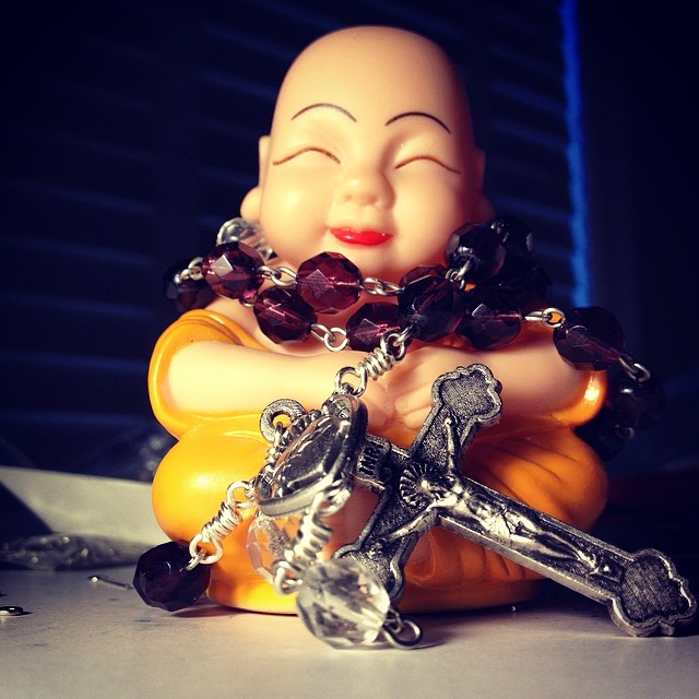 Buddha holds a new rosary.