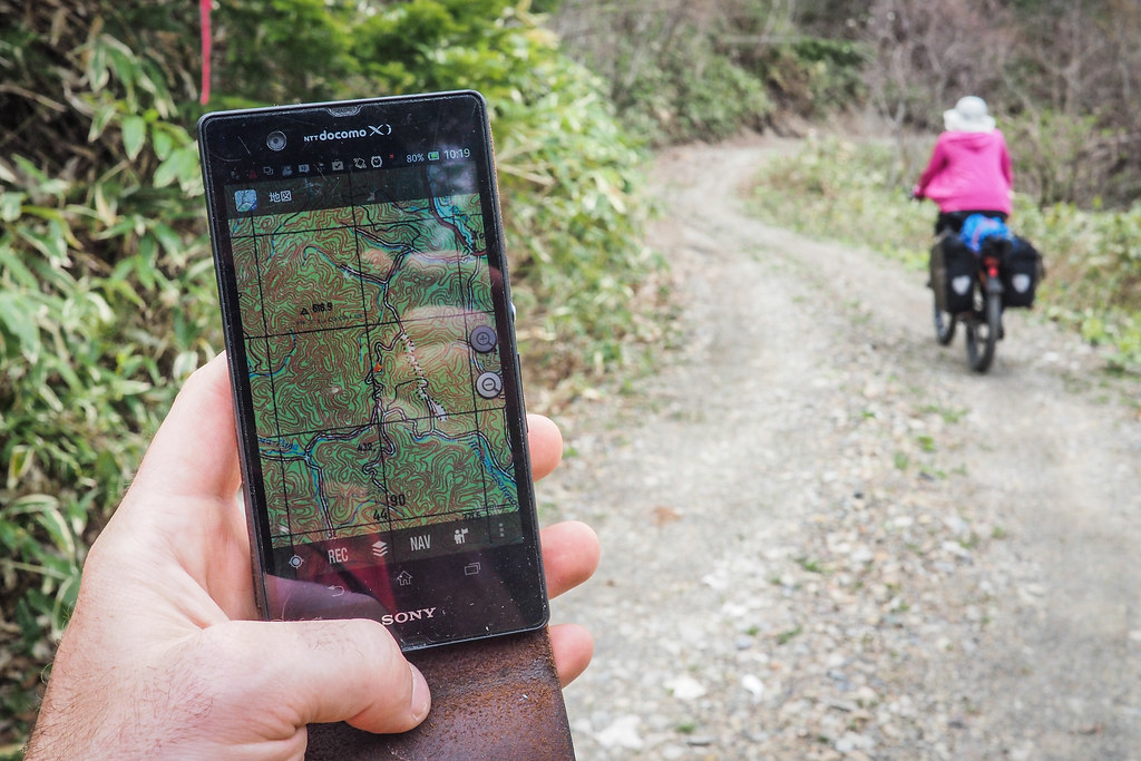 Using Russian military maps for navigation on a dirt road route near Hobetsu, Hokkaido, Japan