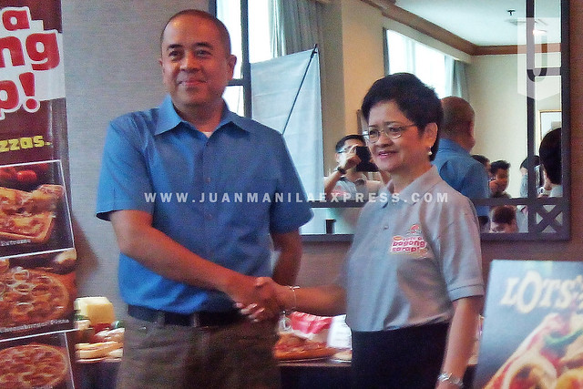 PARTNERS FOR BAGONG SARAP PIZZA. Dole Philippines Sales & Operations Group Head Steve Roman Cabitac and Lot's A Pizza President Teresita Ngan Tan.