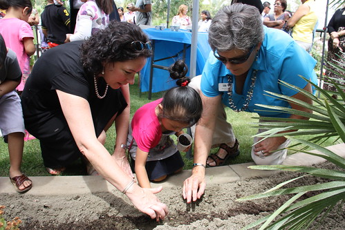 Deputy Under Secretary Patrice Kunesh (left) and California RD State Director Glenda Humiston join children and families to plant a community vegetable garden at Mountain View Estates.