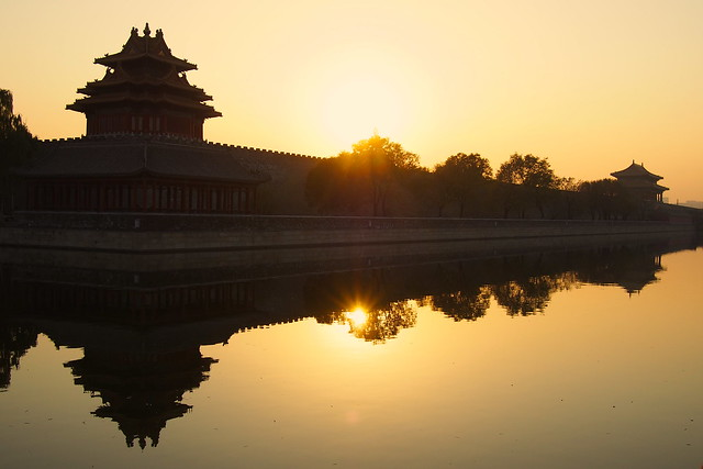 sun setting over the Forbidden City, Beijing, China