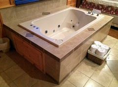 floor, room, jacuzzi, bathtub, plumbing fixture, bathroom, flooring,