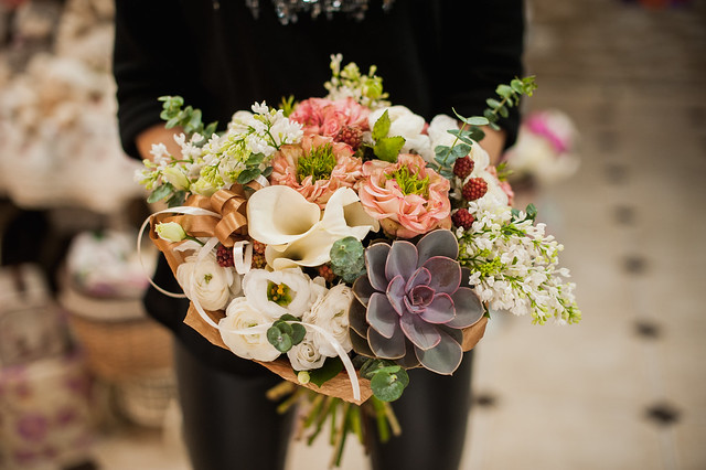 close up of young woman holding bouquet