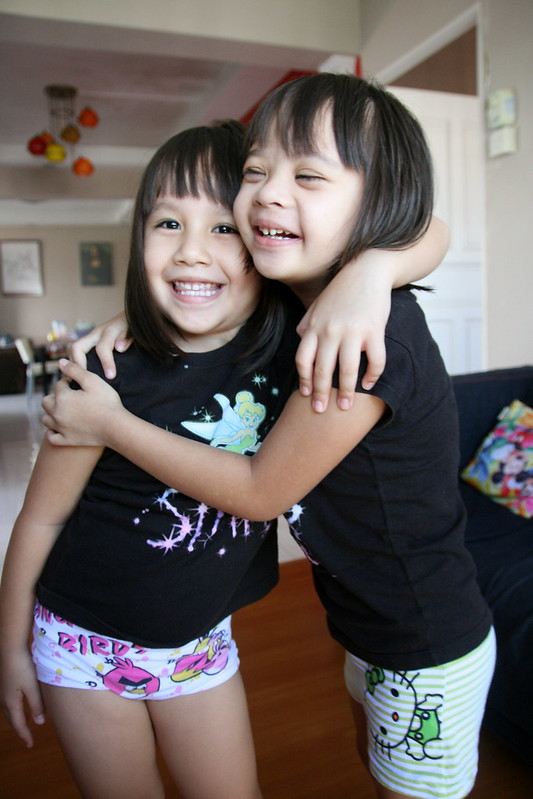 Jolie and Nadine in matching Tinkerbell tees from their cousins