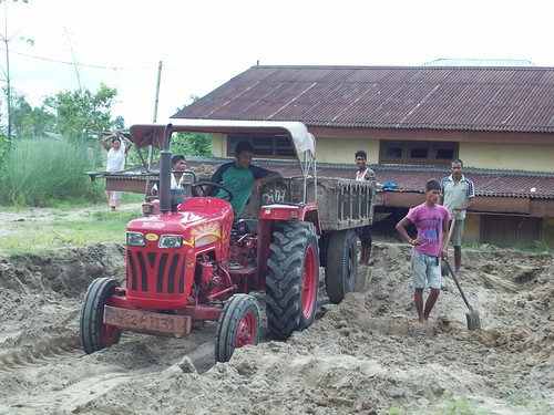 While floods are known to deposit fertile silt on the crop fields, they sometimes carry high sand content also. Sandcasting on the croplands is a major problem. In Dhemaji houses have been affected by it. The picture shows a house being reclaimed.