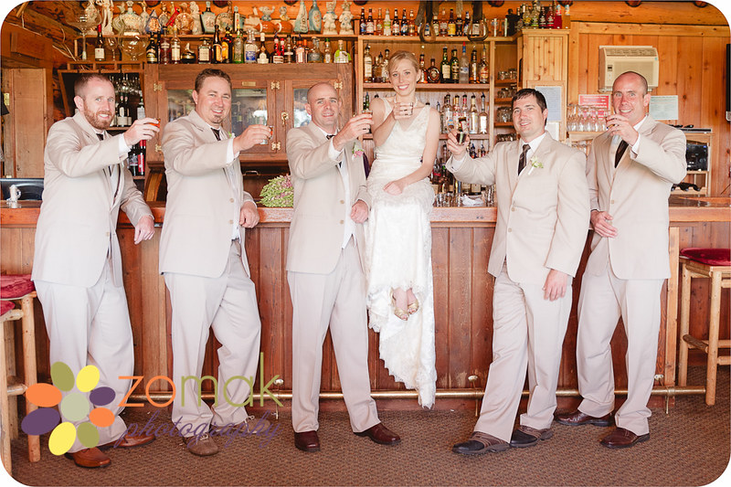 Excellent photo idea by the bride of the wedding party taking shots in the bar.