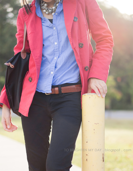 red trench, blue oxford shirt