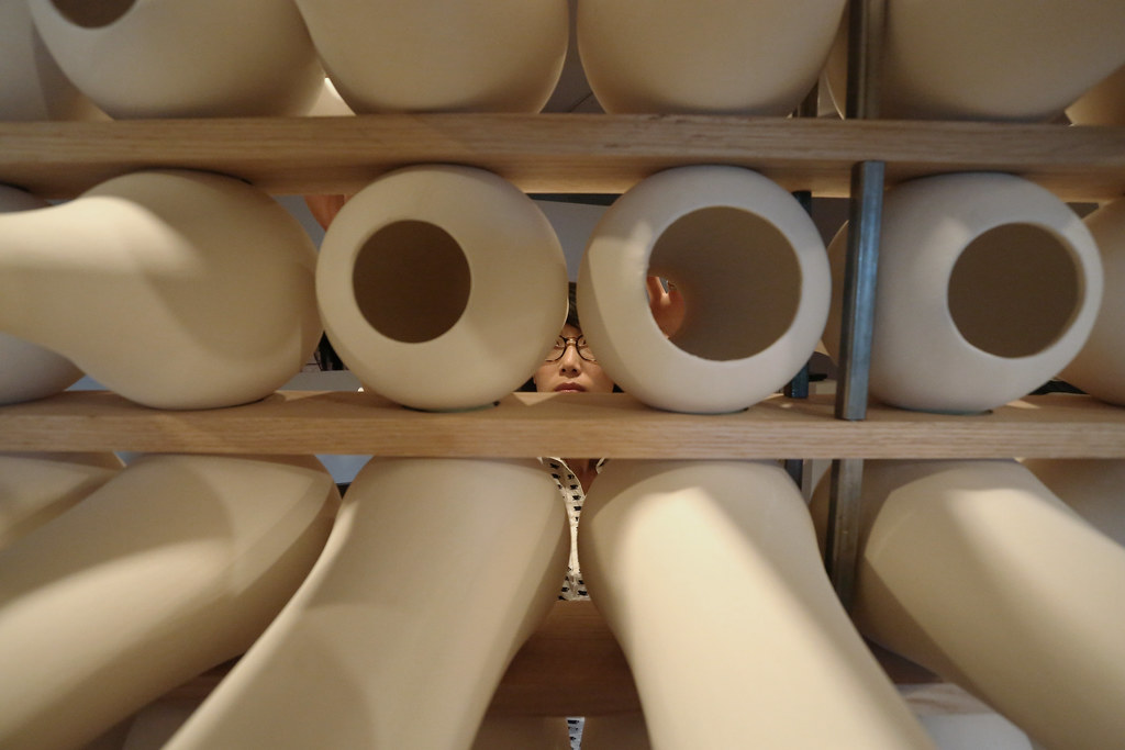 A close in view of the ceramic vessels  that create a wall that alters and filters atmospheric noise.