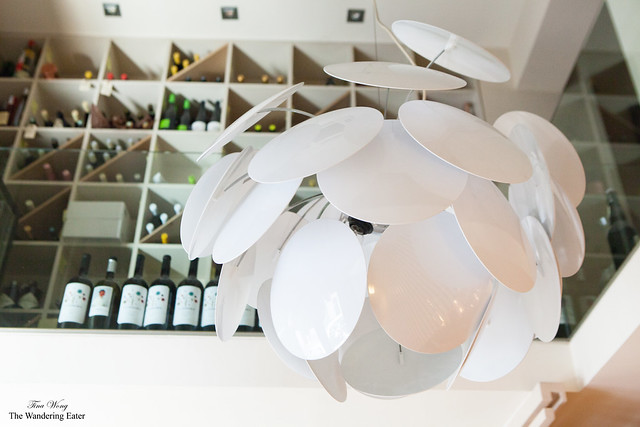 Modern lamp at Alkimia and their wine storage area