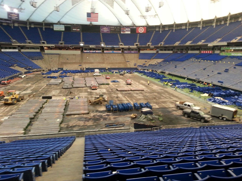 metrodome with some blue seats removed before demolition