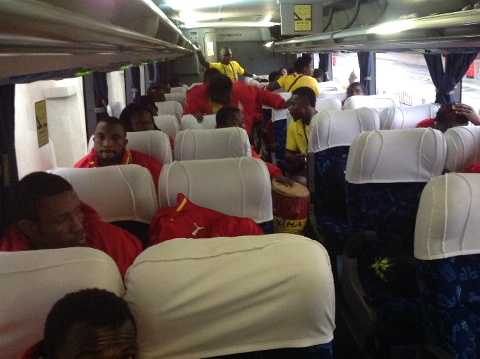Players drumming and dancing in their bus