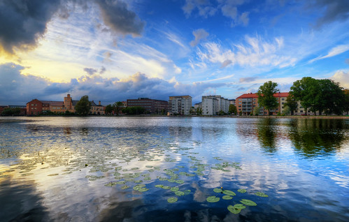city trees houses sunset sky lake water clouds reflections landscape hotel day lily cloudy sweden ripples sverige hdr eskilstuna waterscape eskilstunaån bolinder munktell